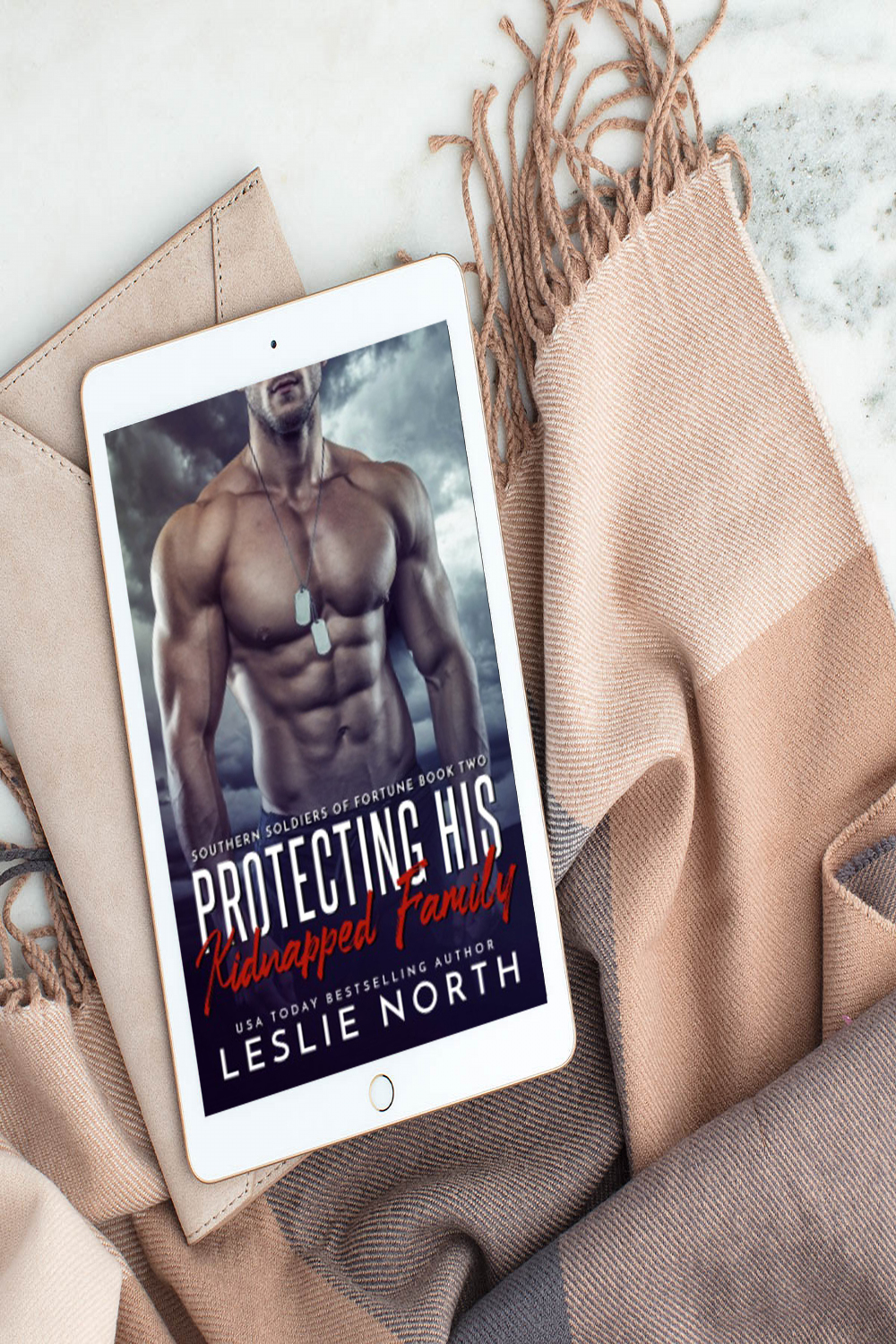 Protecting His Kidnapped Family by Leslie North